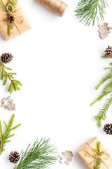 New Year frame with fir branches and present box mockup on white background top view copy space