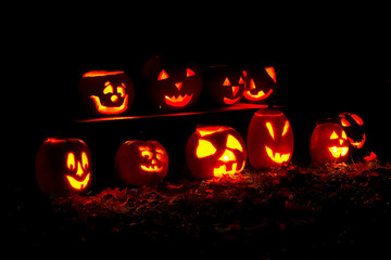 10 lit pumpkins at night