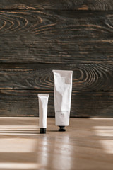 Cosmetic white tube on wooden table