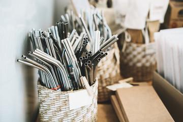 Metallic reusable straws in zero waste shop.