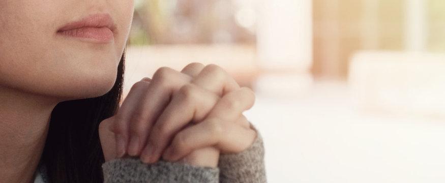Young asian woman praying, teen prayer, hope, gratitude concept, online home church