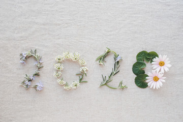 Foto op Aluminium Spa 2020 made from tiny blossoms flowers and leaves, Happy New Year wellness decoration concept