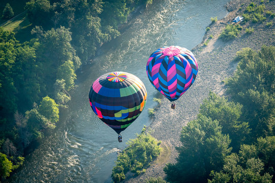 Colorful hot air balloon over the Rogue River in Grants Pass Oregon on a beautiful summer morning