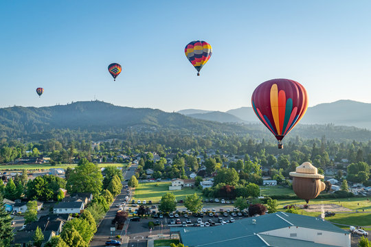 Colorful hot air balloons over Grants Pass Oregon on a beautiful summer morning