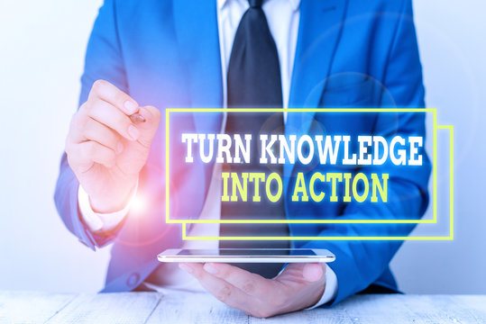 Conceptual hand writing showing Turn Knowledge Into Action. Concept meaning Apply what you have learned Leadership strategies Businessman pointing with pen in empty copy space