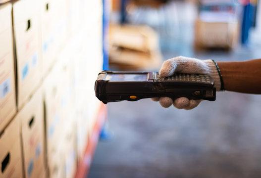 barcode scanner staff wearing white gloves. Barcode reader.
