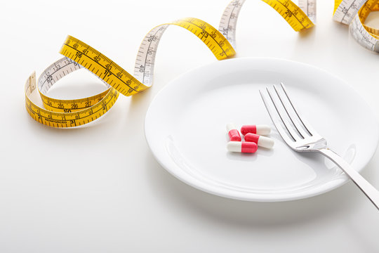 Diet and weight loss concept with supplement
