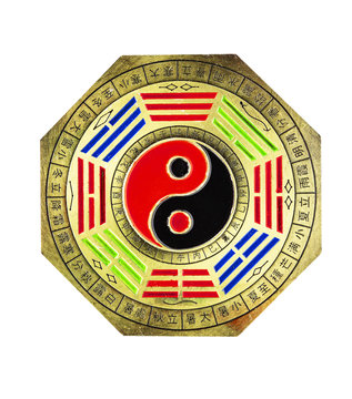 Octagon Chinese feng shui yin yang brass emblem isolated on white background with clipping path