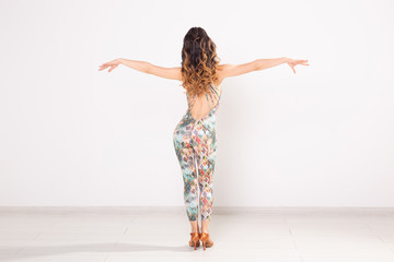 Latina dance, strip dance, contemporary and bachata lady concept - Woman dancing improvisation and...