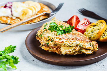 Oatmeal omelet with cheese and sweet oatmeal pancake. Healthy breakfast concept.