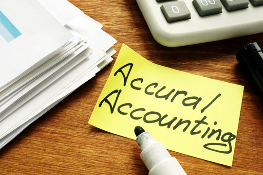 Accrual Accounting concept. Business report and calculator.
