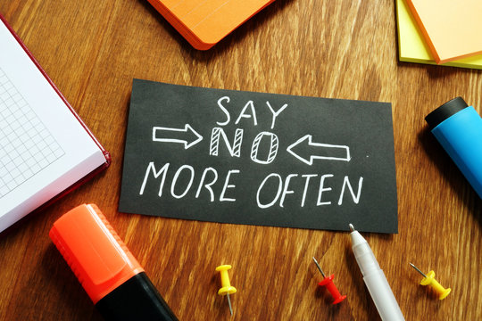 Learn to say no more often sign on the piece of paper.