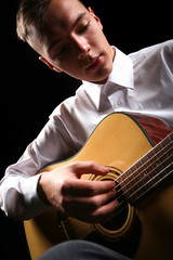 Young men playing the guitar