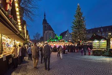 Stuttgart, Germany. Christmas market at Schillerplatz square close to Stiftskirche (Collegiate Church) and Altes Schloss (Old Castle) in dusk.