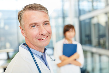 Smiling senior physician with competence and success
