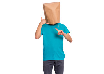 Fototapete - Portrait of teen boy with paper bag over head gesturing with fingers call me, isolated on white background. Child posing in studio showing sign with hand shaped like phone.