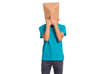 Fototapete - Portrait of teen boy with paper bag over head, covering mouth with hands, isolated on white background. Child posing at studio. Speak no evil concept.