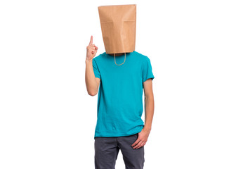 Fototapete - Portrait of teen boy with paper bag over head pointing hands away at copyspace - has an idea, isolated on white background. Child pointing finger up at something.