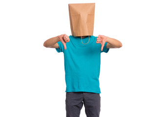 Fototapete - Portrait of teen boy with paper bag over head giving thumb down gesture, isolated on white background. Child with negative expression and disapproval.