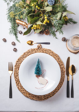 Elegant Christmas place settings, Pine tree figurine on the dish from above