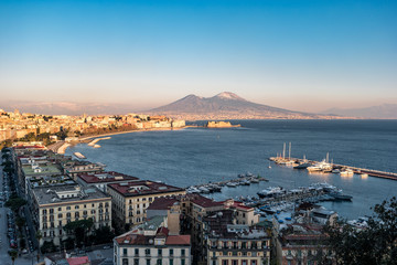 Fotobehang Napels Panoramic view of the famous gulf of Naples, with the Vesuvius on Background at sunset, Naples, Campania, Italy