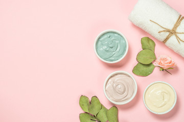 Clay mask on pink bakground, skincare product.
