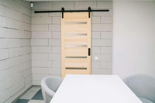 Sliding Barn Door on Foam Brick Wall and Furniture