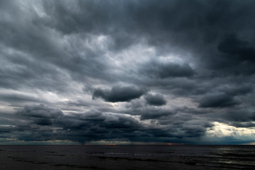 Foto op Plexiglas Grijs Dark clouds over Baltic sea.