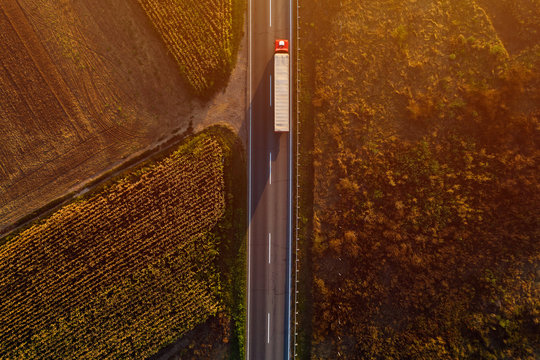 Truck on the road in sunset, top view