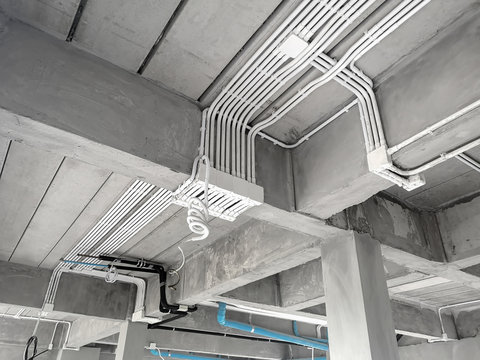 Installation of electrical wiring on the ceiling.Electrical cable system installation.