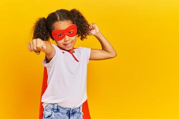 African girl wearing a superhero costume