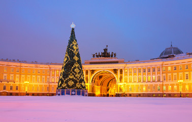 Saint Petersburg in Christmas holidays. Decorated Christmas tree on a snowy Palace Square against the background of General Staff Building. Translation inscription: Merry Christmas and Happy New Year
