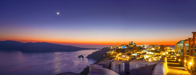 Aluminium Prints Santorini Sunset and the new moon on Santorini Island, top view of Oia, Greece