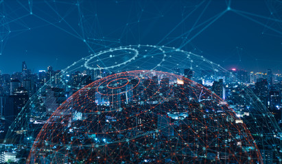 Modern city with wireless network connection and city scape concept.Wireless network and Connection technology concept with city background at night. Fotomurales
