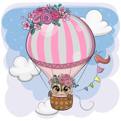 Cartoon Owl is flying on a hot air balloon