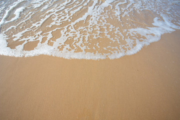 oft wave of blue ocean on sandy beach. Copy space for text Wall mural