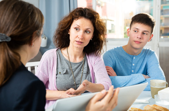 Woman with son meeting with tutor