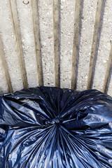 Black plastic rubbish bag.