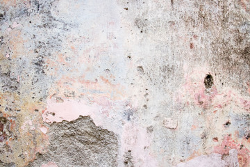 Old background. Old wall with paint peeling off texture in grey and yellow spots. Copy space....
