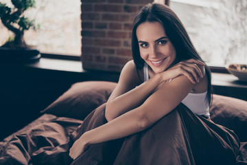 Close-up portrait of her she nice-looking attractive lovely charming winsome sweet pretty cheerful cheery girl sitting in bed enjoying holiday weekend at industrial brick loft modern style room