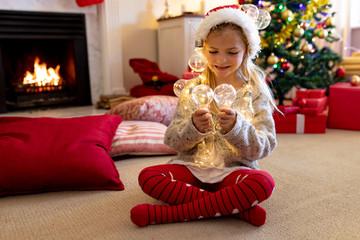Girl at home at Christmas time