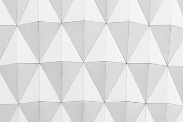 closeup view of white abstract diamond shape pattern architectural wallpaper, background or texture.