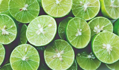 Lime Background. Close up shot of limes. Selective Focus of sliced lime. Wall mural
