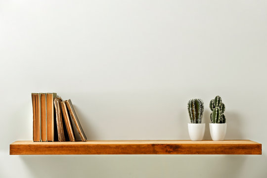 Wooden kitchen shelf of free space for your decoration and gray wall space