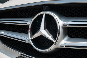 Bangkok, Thailand - September 29, 2019: Mercedes-Benz logo is seen on the front grill of a vehicle.