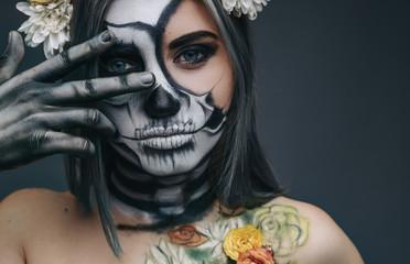 Spooky lady gesturing V sign