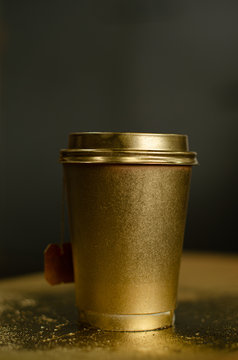 McDonalds cup painted in golden colour on golden background