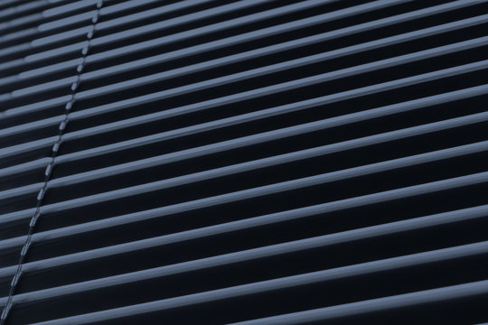 background texture tightly closed shutters in dark room extra close-up