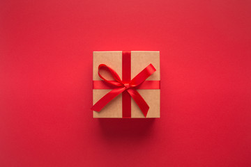 New year present with ribbon isolated on red background
