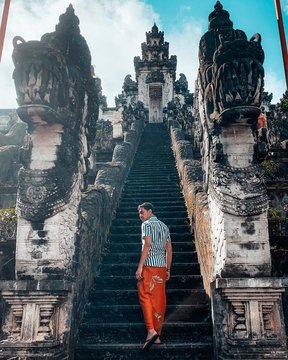Man walking on stairs of temple